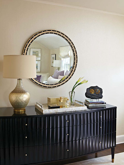 A Barbara Barry bureau with contemporary styling in the master bedroom
