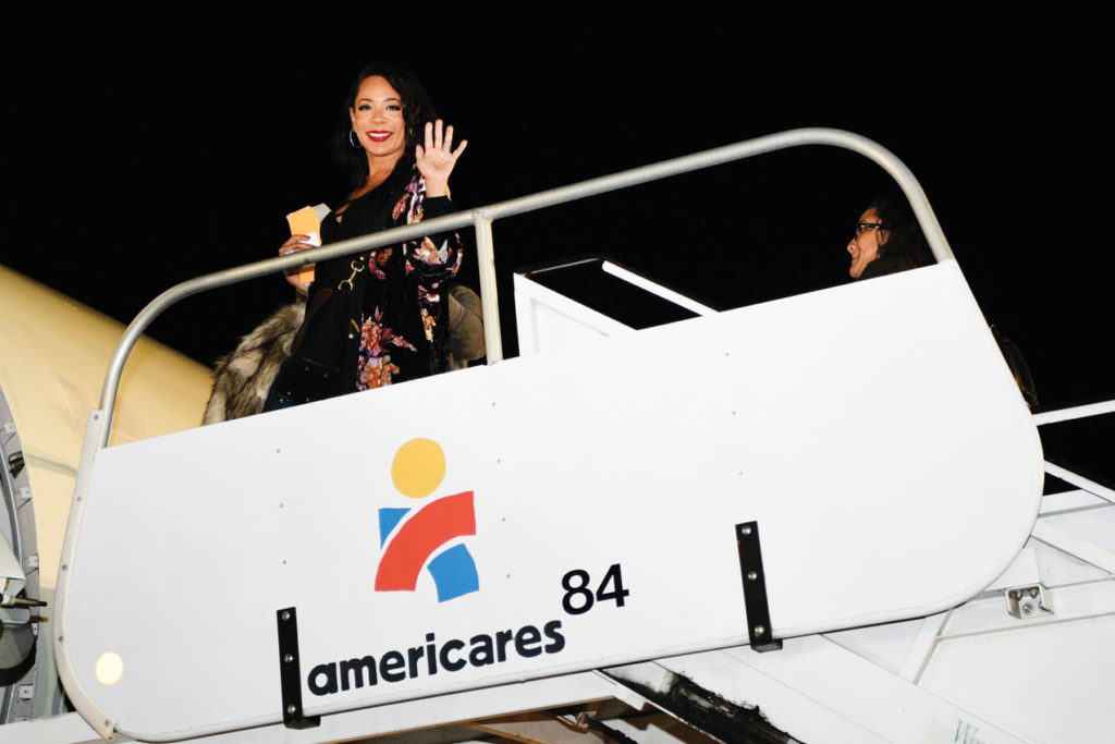 Selenis Leyva boards the plane to the Dominican Republic